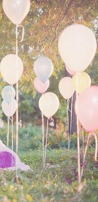 Hold balloons into the ground with golf tees. This would be great for a shower or a child's party!