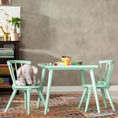 Let your little ones gather in classic style with this lovely 3-piece table and chair set. Crafted of manufactured wood with laminate, each of its pieces is founded on four playfully slanted legs. While a solid finish keeps it looking classic, a rounded square table top and spindle backs on the chairs add a dash of distinction. Simply set it atop a lush shag rug in the play room so your little ones can sit down for pretend tea parties and finger painting, then add extra comfort with a pair…