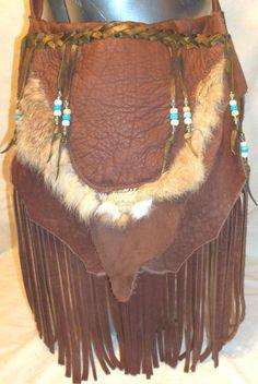 Buffalo Leather Purse Fringed Bag Hobo Vintage Style Handmade in the USA Custom Hippie BUFFALO BAG with Fur handmade by Debbie Leather. $199.95, via Etsy.