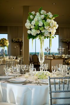 I like the white and green.. But it needs another bolder accent color. Like deep purple! Evening wedding ❤️