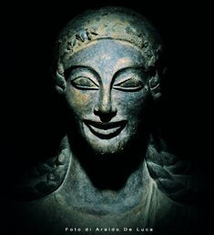"""Apollo De Veio, Etruscan terracotta statue discovered in 1916 - sculpted in the so-called """"international"""" Ionic or late-archaic Etruscan style. The statue was probably made by Vulca, Etruscan artist from the town of Veii. / National Etruscan Museum of Villa Giulia, Rome."""