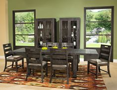 Bring a rustic, forest atmosphere to your dining room with this Calistoga nine-piece dining package. From top to bottom, each item is built using thick pieces of solid pine. The wood is then finished in a weathered charcoal colour and adorned with aged iron metal accents for a look as easy to admire for its beauty as its creativity. Plus, the accompanying chairs offer lustrous faux-leather seating, so each visit to the table is as comfortable and relaxing as possible.
