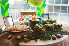 A Wild Rumpus... {1st Birthday Party!} - Skinny Fat Girl Diary  Uses tupperware to create different heights on the table.