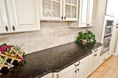 Kitchen Design, Enchanting Traditional Kitchen Cabinets And Table With Antique Brown Granite Countertop And Antique White Bricks Backsplash Also Green Plant And Blonde Laminate Floor Color: Wonderful Alaskan White Granite White Brick Backsplash, Kitchen Backsplash Images, Backsplash For White Cabinets, Kitchen Countertop Materials, Kitchen Countertops, Backsplash Ideas, Ivory Cabinets, Backsplash Tile, Black Cabinets