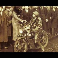 Antique Motorcycles with Women Riders - Lightning Customs Blog --- Aged Photo of a Woman Riding with Guys Wishing They Were