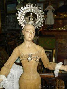 excepciona virgen cap y pota del XVIII, con corona de plata firmada y sellada