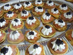 blinis with CHickpea flour/smoked salmon peas/whipped lemon/black olive jam