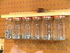 Double up on shelf space! Screw the lids of jars underneath the shelf, and hang the jars underneath. Fill with nuts, bolts, screws, nails, etc.