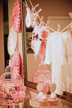 Clothesline ~ Use spray-pained wooden clothespins (pastel pink, baby blue or theme color) onesies, bibs, baby socks, pacifiers.