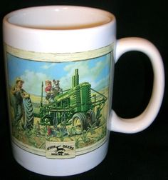 One side features a boy and his dog trying out his dads tractor. Each side reads John Deere Moline IL. John Deere Coffee Mug. Soup Mugs, Tea Mugs, Mugs For Men, John Deere Tractors, Coffee Drinkers, Cream And Sugar, Mug Cup, Tea Set, Cup And Saucer