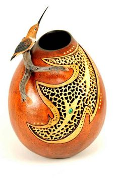 Hummingbird Perch, Bonnie Gibson Gourd Art.   The gourd has an added manzanita branch with a hand carved basswood Rufous hummingbird.  Filigree carving was added in a complementary design.