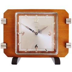 French Art Deco 8-Day Lever Movement Shelf Clock in Blonde Walnut with Chrome and Ebonised Accents | From a unique collection of antique and modern clocks at http://www.1stdibs.com/furniture/more-furniture-collectibles/clocks/