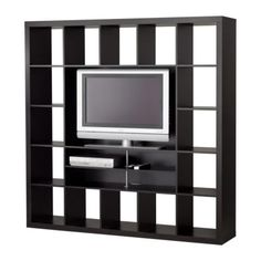 IKEA TV storage unit with cabin-y paper lining the back of each square. Squares filled with wicker and clear cubes for storage.
