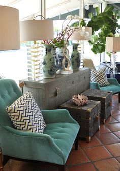 Green upholstery and lucite lighting at Mecox Palm Beach #interiordesign #home #decor #design #MecoxGardens