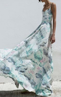 This **Christina Economou** Lily Printed Maxi Dress features an allover print, thin shoulder straps, and a fluid design.