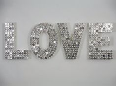 LOVE by Justine Smith - made out of US Quarters (Roughly ninety six dollars worth of quarters.) I think pennies would be better!