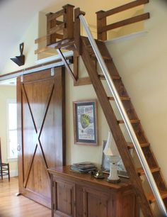 a barn door, teak stairs, and a sleeping loft