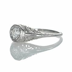 Lindsey...I think you might like this website!  Leigh Jay Nacht Inc. - Replica Art Deco Engagement Ring - 3083-10