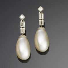 A pair of art deco natural pearl and diamond pendent earrings, circa 1920 by shauna