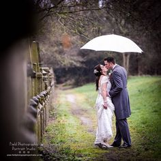 Even when it is raining we still get those precious photographs! #fieldphotographicportraits #fieldphotographic #Wedding #ringwoodhall | From Field Photographic Portrait Studio | http://ift.tt/20TBije