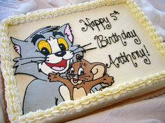 12861.jpg - Tom and Jerry buttercream transfer... this cake was half chocolate, half banana with vanilla buttercream.