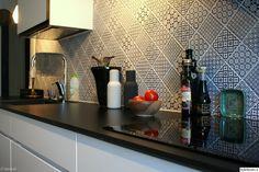 keittiö,kvik,taso,täyslaminaatti,välitila,välitilan laatoitus,keittiön välitila