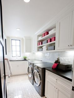 Like the combo of open/closed storage & that the backsplash is finished all the way around. Floor is gorgeous!  Would have run countertop across top of washer/dryer.