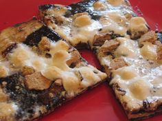 Grilled S'mores Pizza:  ngredients:   16oz Pizza Dough (available in the deli section of your supermarket)  1/4 cup Butter, melted  1/4 cup Brown Sugar  3/4 cup Premium Hot Fudge   6 Whole (rectangle) Graham Crackers, crushed  1 1/2 cups Mini-Marshmallows   Flour, as needed