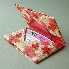 How to make an origami gift card holder.