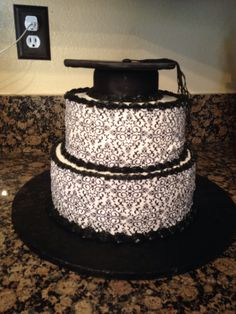 Graduation cake for my best friend  niece . Too cake is Chocolate cake with Mexican chocolate filling. Bottom cake is vanilla cake with lemon curd  lemon cream filling.