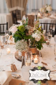 The Bridal Dish says I DO to this beautiful centerpiece!  Find flower designer for your wedding: http://www.thebridaldish.com/vendors/listings/C7