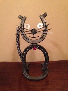 Hey, I found this really awesome Etsy listing at https://www.etsy.com/listing/221596040/horseshoe-cat