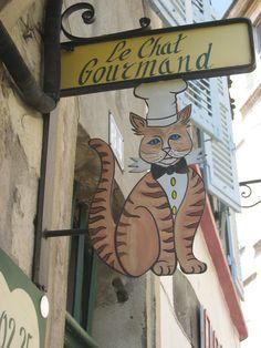 Restaurant Sign in Avignon, France.