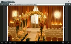 Arranged flowers down the aisle and flower arch.  Not sure about the flowers