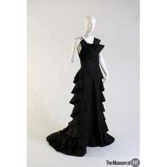 Evening dress      People and Brands:  Designer: Vionnet  1876-1976    Medium: Black silk taffeta  Date: 1936