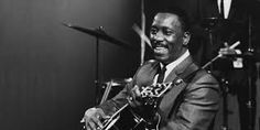 """Wes Montgomery was a self-taught musician who learned by ear. He is known for developing an unusual guitar technique by playing in octaves, while soloing. In 1965, Wes began to crossover into pop/jazz style where he prospered and gained recognition outside of jazz circles. In 1966, he won a Grammy Award for """"Best Instrumental Jazz Performance."""" At the height of his popularity, he died of a heart attack leaving an unprecedented legacy as one of the great jazz innovators and improvisors."""