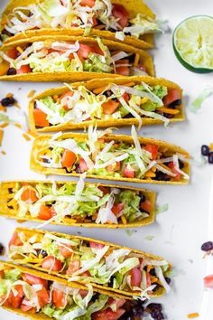 Vegetarian Black Bean Tacos served in crunchy corn shells and filled with classic taco toppings are so good that you definitely won't miss the meat. #blackbeantacos #tacos