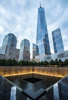 FIRM: Handel Architects LLP; PROJECT: National September 11 Memorial; LOCATION: New York, NY, USA. Designed to encourage the democratic values of public assembly and the resiliency of public space, and features 2 sunken reflecting pools that puncture the flat plaza.