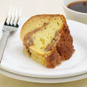 """Maple Walnut Coffeecake - Instead of a crumbly streusel, this sour cream coffeecake gets a maple syrup """"filling"""" chock full of walnuts. Serve with coffee or tea. #recipes #walnuts #cake"""