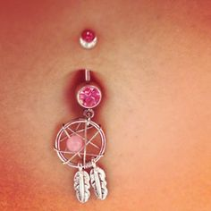 Is that a dream catcher?? THAT'S A DREAM CATCHER!! Oh how I love those things!!! Gotta have this done also.....
