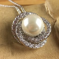 Zircon Swirl Pearl Pendant Rhodium Necklace LA N2054. Starting at $1