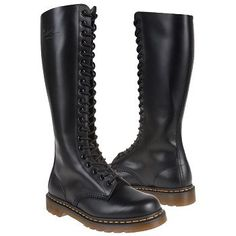 Doc Marten knee-high combat boots. I always have loved Doc marten boots, especially black and blue.  I owned two pairs in my life.  I always wanted to own this style.