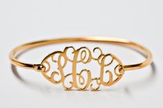 Love this gold monogram bracelet