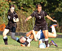 Sissonville senior Shelby Swiney tries to free herself from being tangled up with Herbert Hoover sophomore Cassandra Hammes as Indians sophomore Taylor Legg follows the action during Sissonville's 7-0 win over the Huskies on Monday in Falling Rock.