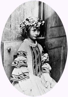 Alice Liddell. The real 'Alice In Wonderland.'  Lewis Carroll.  http://en.wikipedia.org/wiki/Lewis_Carroll#