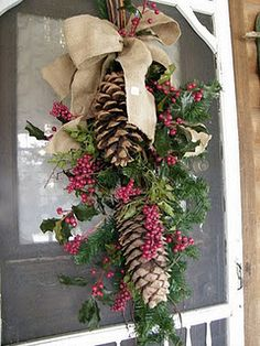 love the burlap, pinecones, shot of color, everything....GREAT FOR AFTER CHRISTMAS ON FRONT DOOR FOR WINTER SEASON