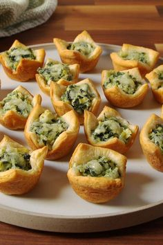 The 78 Most Delish Holiday Appetizers :: Nothing gets a party started quite like food. :: Spinach Artichoke Cups