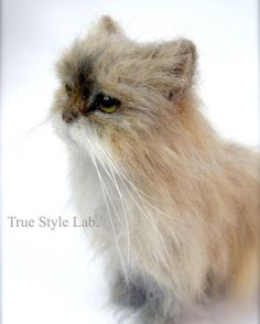 Terumi Ohta uses the art of needle felting to create realistic creatures such as this long haired cat.