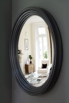 """This handsome convex mirror measures 41"""" diameter. Large mirrors create a sense of space and enhance the light by bouncing those precious rays of sunshine around the room. Convex mirrors are especially effective in generating light due to the curved shape of the mirror lens. They also enhance the perception of depth in a room due to their all inclusive reflection, making them a great choice in narrow rooms, hallways and stairways.  #largeroundmirrors #largeconvexmirror #hallwaymirror #convex Convex Mirror, Round Wall Mirror, Round Mirrors, Wall Mirrors, Extra Large Round Mirror, Large Black Mirror, Entryway Mirror, Foyer, Narrow Rooms"""