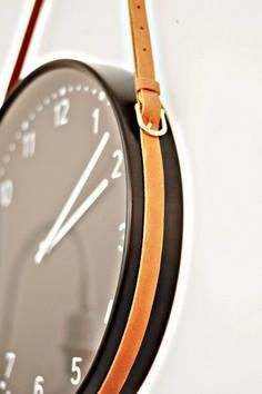 An old leather belt used to hang a clock for a rugged, interesting look.
